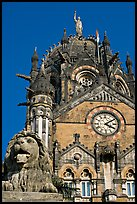Lion and Gothic tower topped by 4m-high statue of Progress, Victoria Terminus. Mumbai, Maharashtra, India (color)