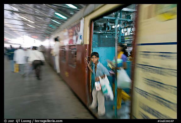 View of departing train with motion blur. Mumbai, Maharashtra, India
