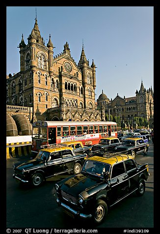 Black and Yellow cabs in front of Victoria Terminus. Mumbai, Maharashtra, India (color)