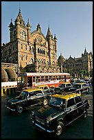 Black and Yellow cabs in front of Victoria Terminus. Mumbai, Maharashtra, India