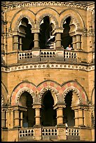Facade with woman at window, Chhatrapati Shivaji Terminus. Mumbai, Maharashtra, India (color)