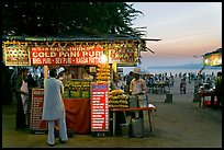 Food kiosks at sunset, Chowpatty Beach. Mumbai, Maharashtra, India