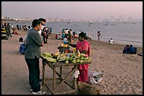 Food stall selling braised corn at twilight,  Chowpatty Beach. Mumbai, Maharashtra, India