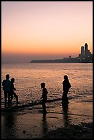 Beachgoers and skyline, Chowpatty Beach. Mumbai, Maharashtra, India (color)