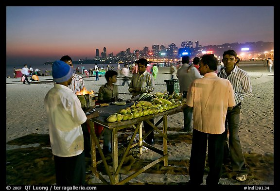 Stall broiling corn at night, Chowpatty Beach. Mumbai, Maharashtra, India (color)
