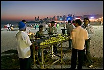 Stall broiling corn at night, Chowpatty Beach. Mumbai, Maharashtra, India