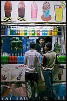 Stall with colorful drinks, Chowpatty Beach. Mumbai, Maharashtra, India (color)