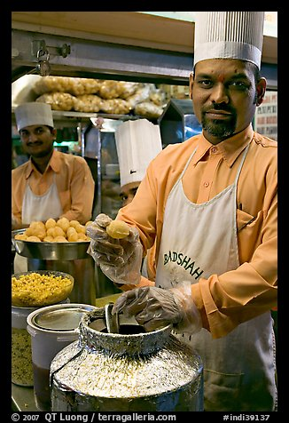 Cooks in food stall, Chowpatty Beach. Mumbai, Maharashtra, India (color)