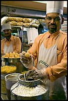 Cooks in food stall, Chowpatty Beach. Mumbai, Maharashtra, India