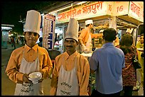 Cooks in front of Panipuri stall, Chowpatty Beach. Mumbai, Maharashtra, India