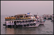 Tour boat at twilight. Mumbai, Maharashtra, India (color)