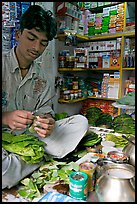 Street vendor preparing a snack with leaves. Mumbai, Maharashtra, India (color)