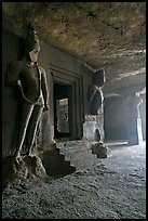 Figures of Dwarpala on Shiva shrine, Elephanta caves. Mumbai, Maharashtra, India (color)