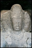 Triple-headed Shiva sculpture, Elephanta caves. Mumbai, Maharashtra, India (color)