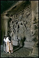 Family looking at Ardhanarishwar Siva sculpture, main Elephanta cave. Mumbai, Maharashtra, India (color)