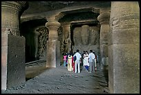 Vistors in main cave, Elephanta Island. Mumbai, Maharashtra, India