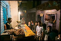 Street with vendor of sweets by night, Taj Ganj. Agra, Uttar Pradesh, India