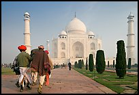 Men walking toward Taj Mahal, early morning. Agra, Uttar Pradesh, India (color)