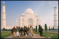 Men with turbans and cows in front of Taj Mahal, early morning. Agra, Uttar Pradesh, India ( color)