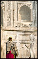 Woman standing at the base of Taj Mahal. Agra, Uttar Pradesh, India (color)