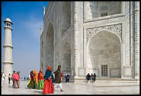 Base of Taj Mahal, minaret, and visitors. Agra, Uttar Pradesh, India (color)