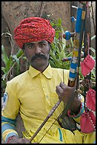 Musician with string instrument. Agra, Uttar Pradesh, India (color)
