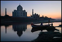 Boat on Yamuna River in front of Taj Mahal, sunset. Agra, Uttar Pradesh, India