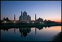 Taj Mahal complex reflected in Yamuna River at sunset. Agra, Uttar Pradesh, India