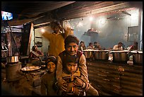 Children and food booth at night, Agra cantonment. Agra, Uttar Pradesh, India ( color)