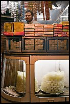 Store selling peitha squares, a local sweet. Agra, Uttar Pradesh, India (color)