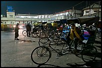 Cycle-rickshaws in front of train station. Agra, Uttar Pradesh, India (color)