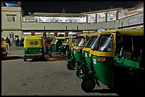Auto-rickshaws in front of train station. Agra, Uttar Pradesh, India (color)