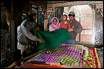 Family making offering inside Shaikh Salim Chishti mausoleum. Fatehpur Sikri, Uttar Pradesh, India