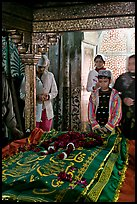 Family making offering on Shaikh Salim Chishti tomb. Fatehpur Sikri, Uttar Pradesh, India (color)