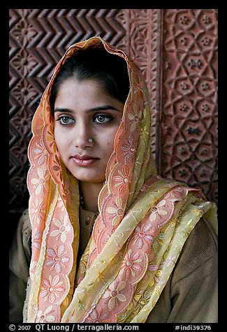 Young woman with embroided scarf, in front of Rumi Sultana wall. Fatehpur Sikri, Uttar Pradesh, India (color)