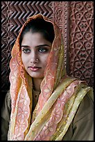 Young woman with embroided scarf, in front of Rumi Sultana wall. Fatehpur Sikri, Uttar Pradesh, India