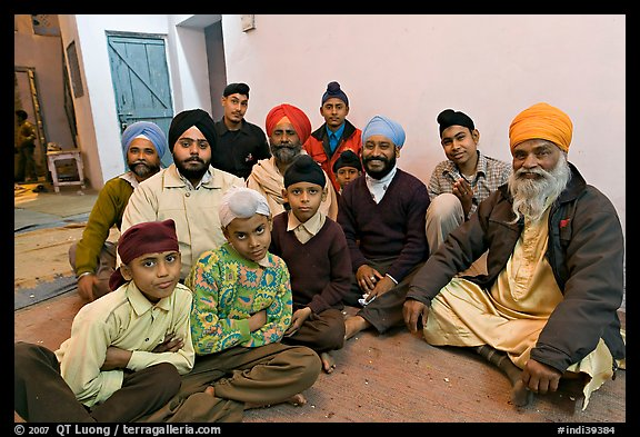 Sikh men and boys in gurdwara. Bharatpur, Rajasthan, India (color)