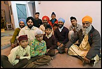 Sikh men and boys in gurdwara. Bharatpur, Rajasthan, India