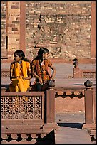 Young women sitting in the center of Ornamental pool. Fatehpur Sikri, Uttar Pradesh, India