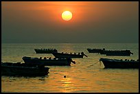 Boats anchored in bay and sunrise, Dona Paula. Goa, India