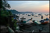 Fishing boats on beach, sunrise. Goa, India