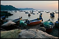 Fishing nets and boats, sunrise. Goa, India