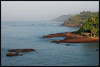 Coastline, palm trees, and clear waters, Dona Paula. Goa, India (color)