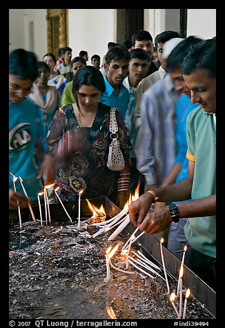 Popular candle burning spot, Basilica of Bom Jesus, Old Goa. Goa, India (color)