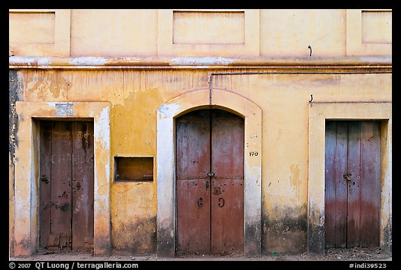 Facade painted yellow, Panjim. Goa, India