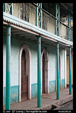 House with balconies painted green, Panjim. Goa, India (color)