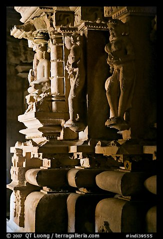 Statues in the corridor (pradakshina), Parsvanatha temple, Eastern Group. Khajuraho, Madhya Pradesh, India (color)