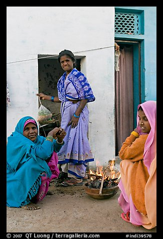 Women cooking outside in village. Khajuraho, Madhya Pradesh, India (color)