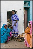 Women cooking outside in village. Khajuraho, Madhya Pradesh, India