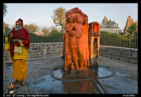 Holy man next to Shiva image. Khajuraho, Madhya Pradesh, India (color)